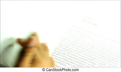 leafing through a book