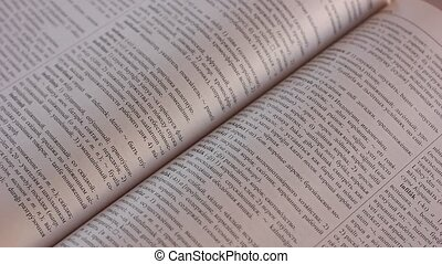 Leafing through pages of dictionary