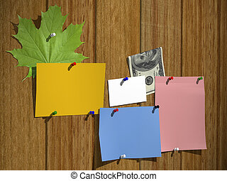 leaflets on a wooden wall