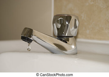 Leaking tap - Drop of water from a leaking tap