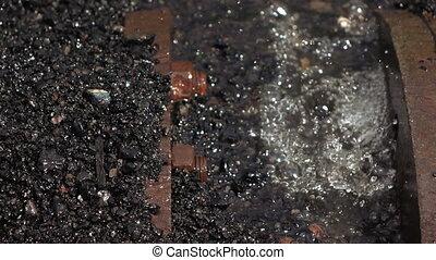Leaking water pipe - Most flowing metal pipe slag thermal...