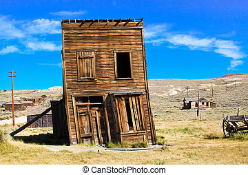 Old building propped up by a wooden post in an old west ghost town.