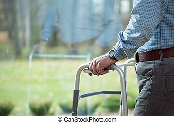 Leaning on walker