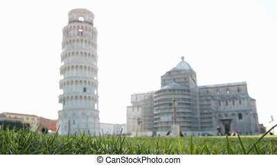 PISA, ITALY - March 07, 2014: Tourists visit Miracles square, Piazza dei miracoli in Pisa, Italy . This is one of the main centers for medieval art in the world.