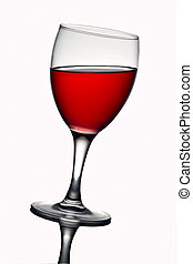 Leaning wine glass with red wine. With reflections in the ...