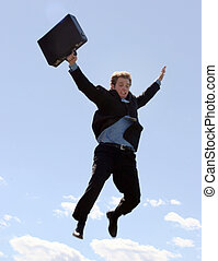 Businessman finally understands that success requires risks, and so he leaps as he holds onto his briefcase