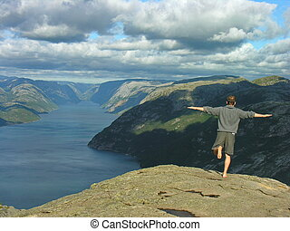 Leap of faith - Preikestolen peak, leap of Feith into Fjord