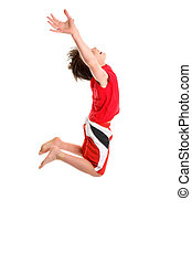 A happy boy leaps mid jump with hands stretched towards the sky.