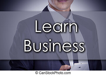 Learn Business - Young businessman with text - business concept