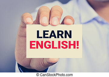 LEARN ENGLISH ! message on the card held by a man hand