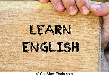 Learn english text concept - Human hand over wooden ...