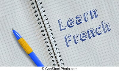 Learn French. Text handwritten on sheet of notebook and ...