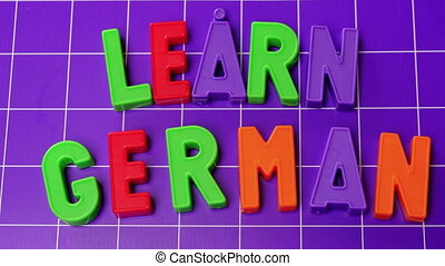 learn german language alphabet on magnets letters .