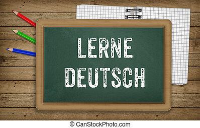 Learn German language, chalk on green board, education concept