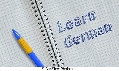 Learn German. Text handwritten on sheet of notebook and ...
