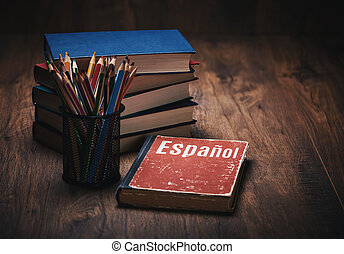 learn Spanish. Book on a wooden table