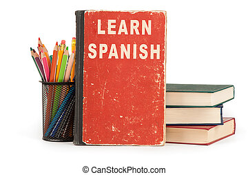 learn spanish language. school supplies on white