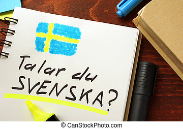 Learn swedish written in a notepad. Education concept.