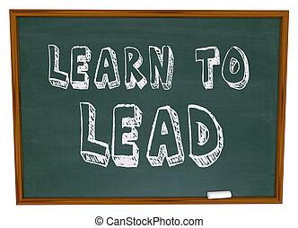 The words Learn to Lead written on a chalkboard