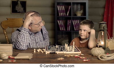 Learn to Lose - Impatient boy strewing chess pieces around...