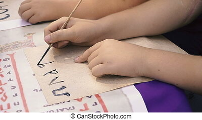 Learn to write. Children learn to write letters