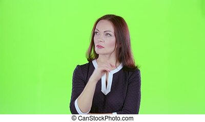 Learned woman thinks of different theories. Green screen -...