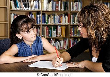 Learning - A little girl learning from her teacher.