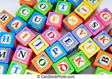 Learning and education concept - pile of alphabet blocks