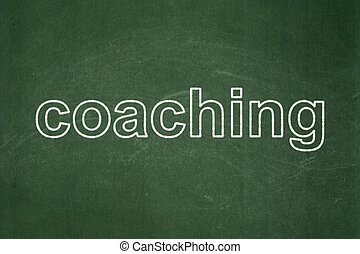 Learning concept: Coaching on chalkboard background