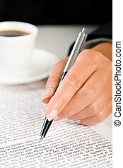 Learning contract conditions - Close-up of female�s hand...
