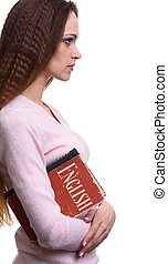 Learning English concept. Girl holds a book