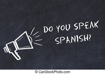 Learning foreign languages concept. Chalk symbol of loudspeaker with phrase do you speak spanish