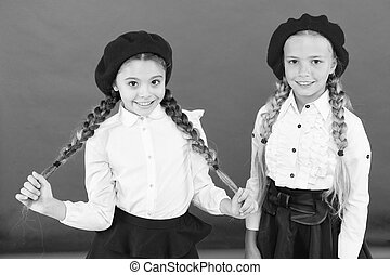 learning french. happy children in uniform. friendship and...