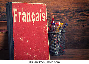 learning French concept. book on a wooden background