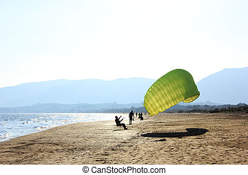 Learning how to do paragliding - Lessons on a beach