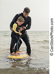 Learning how to Surf at the Beach