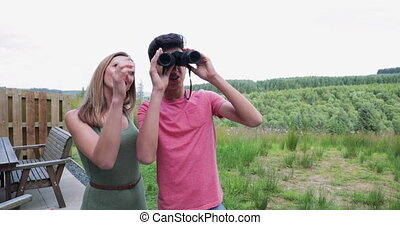 Learning how to use the Binoculars - Mother showing son how...