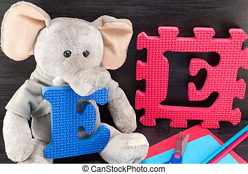 Learning letters, e like elephant with a toy