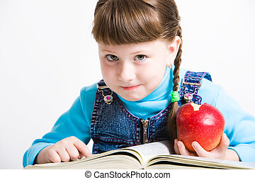 Learning - Portrait of little girl with red apple in hand ...