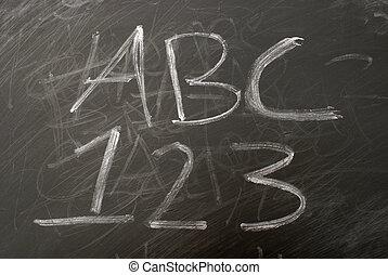 Learning the basics of the english language on a chalkboard.