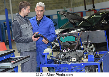 learning the job during a practical internship in a garage