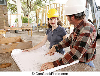 Learning the Trade - A construction apprentice listening as...