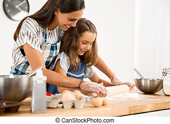 Learning to bake - Shot of a mother and daughter having fun...