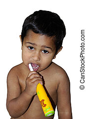 An young toddler learning to brush his teeth