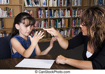 Learning To Count - A teacher helps a child count on her...