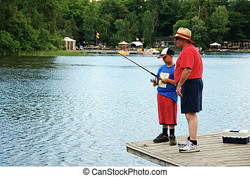 Learning to Fish - Granddad teaching his grandson to fish