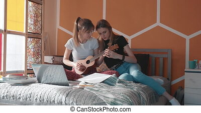 Learning to play ukulele with a friend