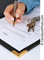 Hand and pen signing the contract for a new home - the text of the contract is purely fictitious
