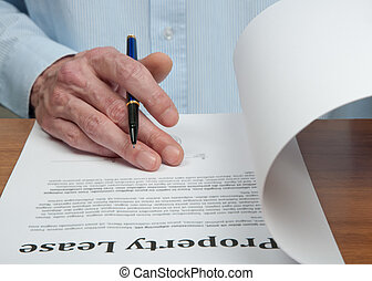 Lease Contract - Male businessmen is reading the property...