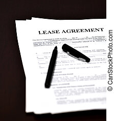 Lease Document Agreement on Desk with Pen - Lease document...